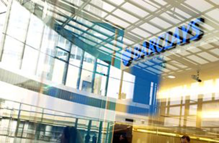 Barclays scales back investment banking